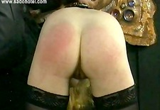 Crying slave with big tits is spanked on her ass by her master