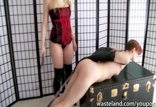 Blonde dominatrix uses her ginger female sex slave