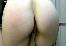 Milf slave with big tits gets naked and spanked on her pussy and ass
