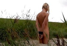 Blonde bitch leash and spanked on the beach