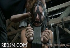 Hard spanking for masked babe