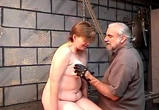 Old wenchs bawdy wazoo goes red from spiked glove flogging in dungeon