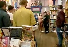 Busty brunette slave undressed in public library then penetrated