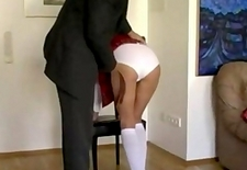 Schoolgirl whipped with a strap