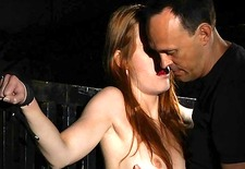 Beautiful redhead restrained for a kinky rite
