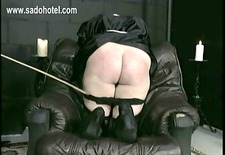 Beautiful nun slave bends over with her panties down is spanked on her ass by priest