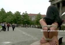 Brunette undressed and disgraced in public plazza sex tied and wa