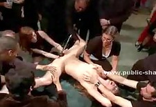 Slut tied naked and immobilized in a room full of public gets her