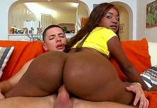 Diamond Mason is a gorgeous ebony cutie with a big, juicy ass. She enjoys having her booty spanked while she receives a stiff boner from behind.