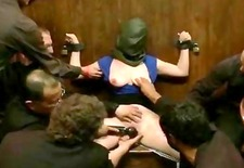 Bitch tied with her head covered gets spanked and humiliated by gang of nasty men and women