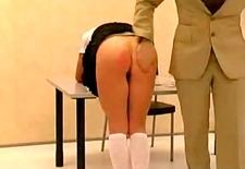 Girl being spanked hard by teacher