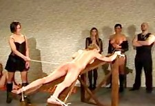 Girl gets a brutal caning while people watch