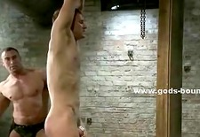 Strong man naked takes his time to study his sex slave tied in ch